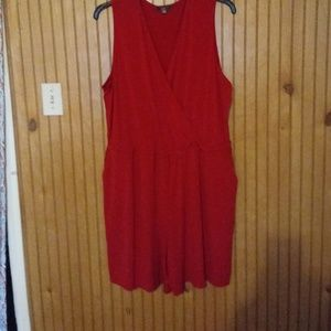 A red romper with pockets